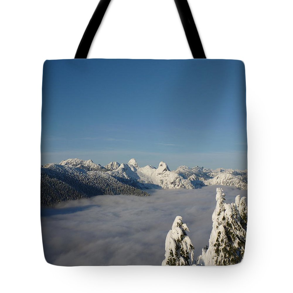 Winter Tote Bag featuring the photograph Above The Clouds by Anders Skogman