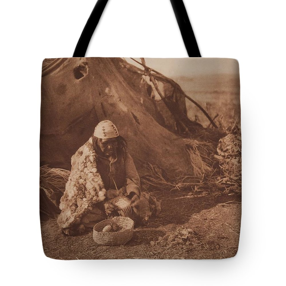 Native Tote Bag featuring the painting Achomawi Basket-maker Ca 1923 , Native American By Edward Sheriff Curtis, 1868 - 1952 by Edward Sheriff Curtis
