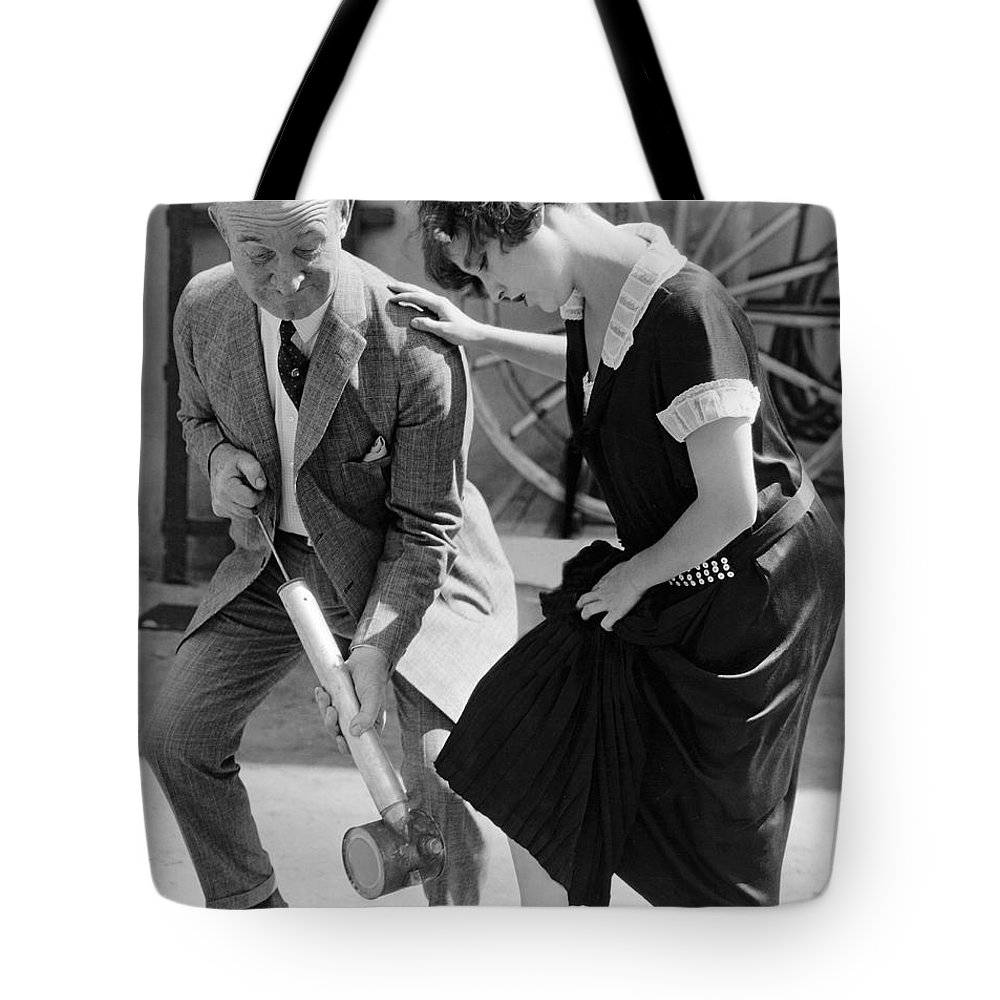 1035-932 Tote Bag featuring the photograph Actress Gets Feet Sprayed by Underwood Archives