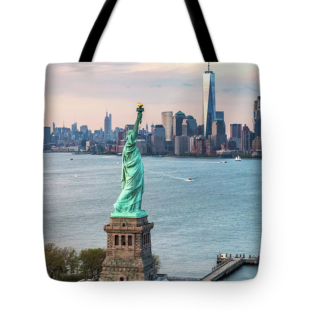 Statue Of Liberty Tote Bag featuring the photograph Aerial Of The Statue Of Liberty At Sunset, New York, Usa by Matteo Colombo