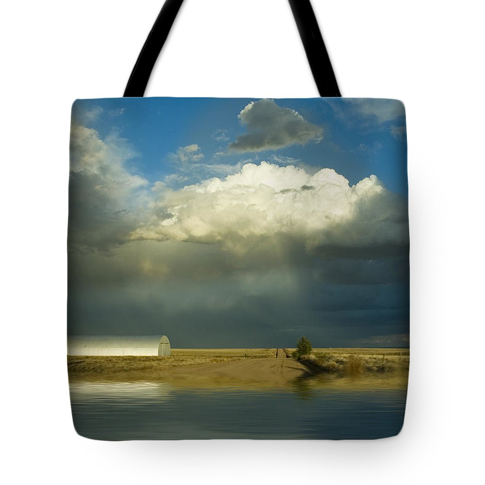 Storm Tote Bag featuring the photograph After The Storm by Jerry McElroy