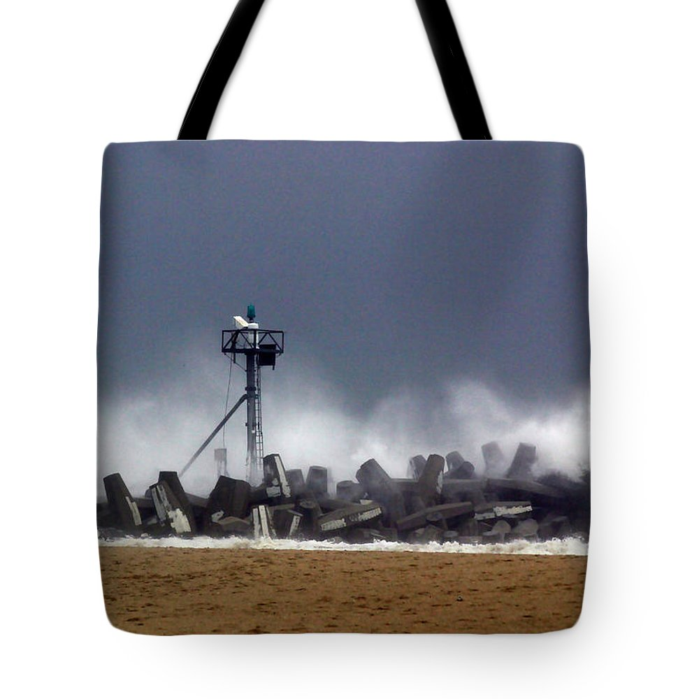Seascape Tote Bag featuring the photograph Against The Breakers by Mary Haber