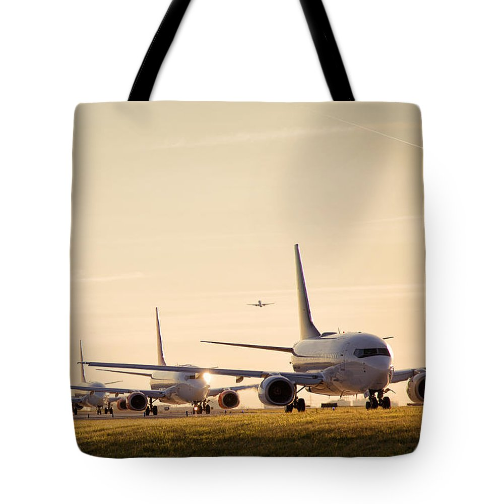 Boeing Tote Bag featuring the photograph Airplanes Lining Up For Take-off by Raymond Persaud