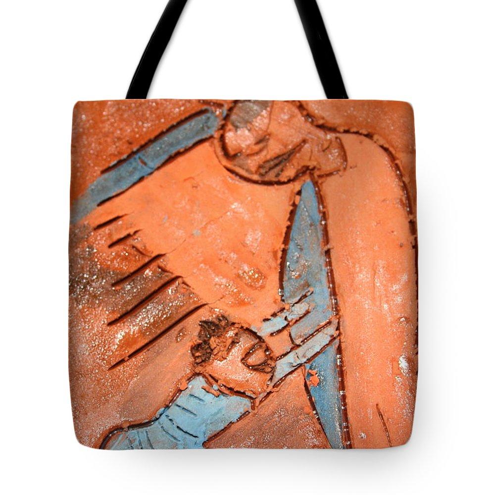 Jesus Tote Bag featuring the ceramic art Akili - Tile by Gloria Ssali