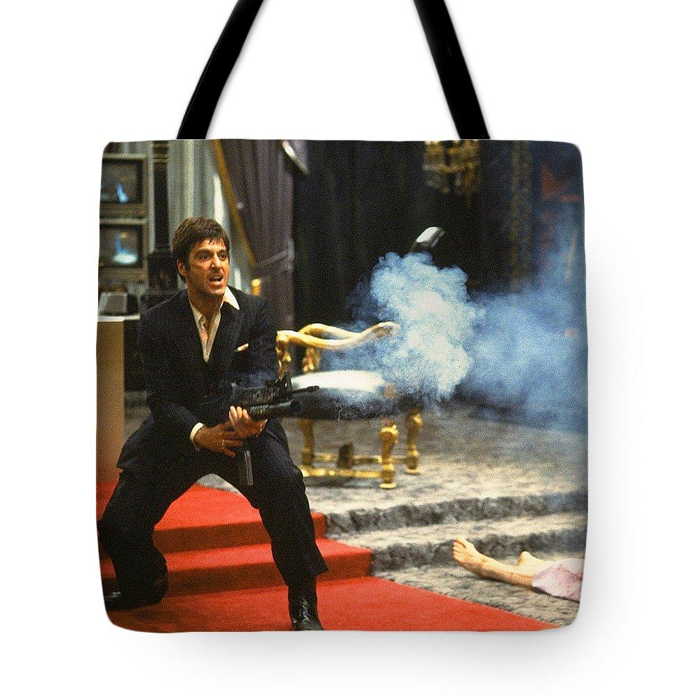 Al Pacino Tony Montana Machine Gun Blasting Bad Guys Scarface 1983 Tote Bag featuring the photograph Al Pacino As Tony Montana With Machine Gun Blasting His Fellow Bad Guys Scarface 1983 by David Lee Guss