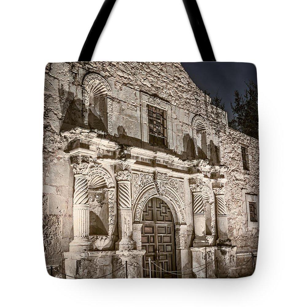Joan Carroll Tote Bag featuring the photograph Alamo Door by Joan Carroll