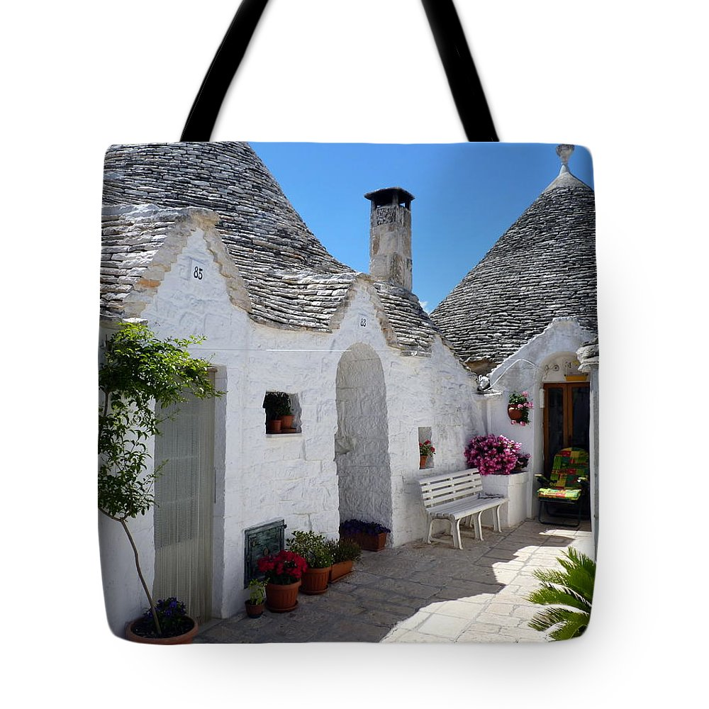 Alberobello Tote Bag featuring the photograph Alberobello Courtyard With Trulli by Carla Parris