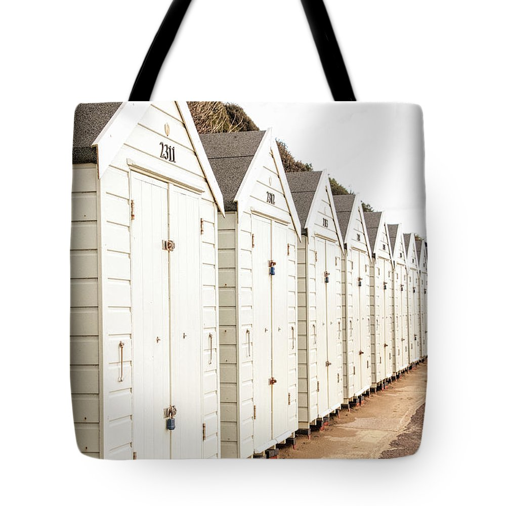 All In A Row Tote Bag featuring the photograph All In A Row by Phyllis Taylor