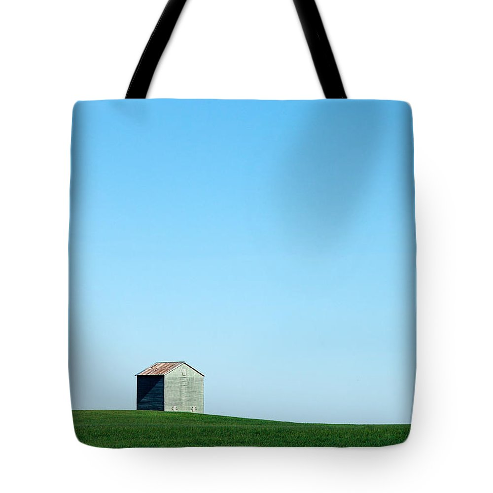 Bin Tote Bag featuring the photograph Alone On The Plains by Todd Klassy