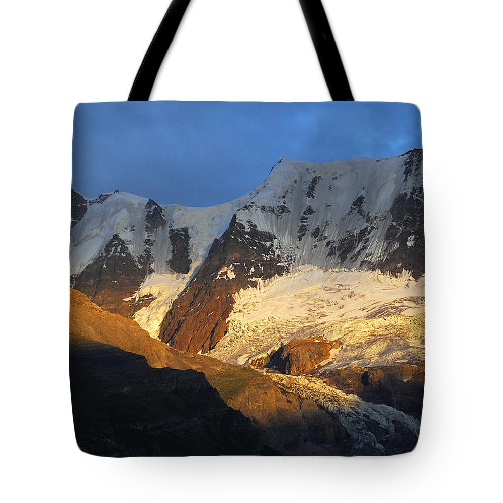 Murren Tote Bag featuring the photograph Alpenglow On The Swiss Alps Near Murren by Anne Keiser