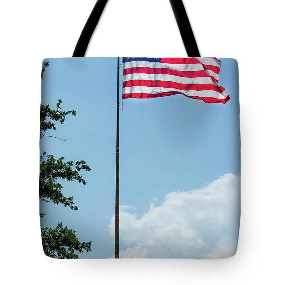 Flag Tote Bag featuring the photograph American Flag Flying Proud by By Way of Karma