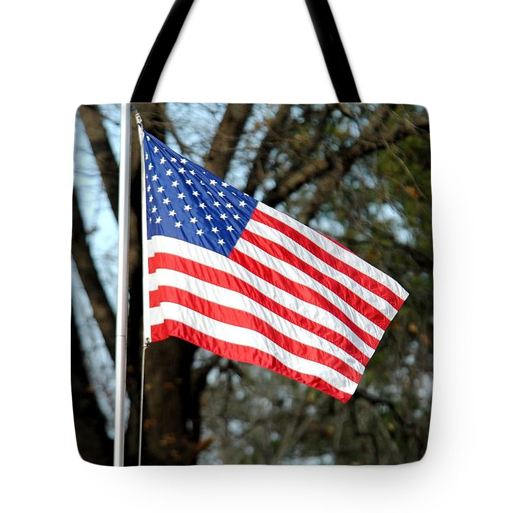 American Tote Bag featuring the photograph American Flag by Jai Johnson