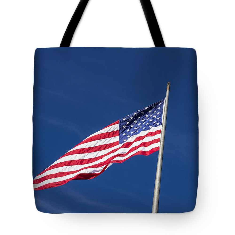 American Flag Tote Bag featuring the photograph American Flag Waving In The Breeze by John Trax