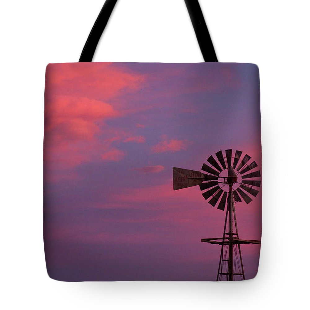 Windmills Tote Bag featuring the photograph American Old Farm Water Pumping Windmill With A Sunset by James BO Insogna