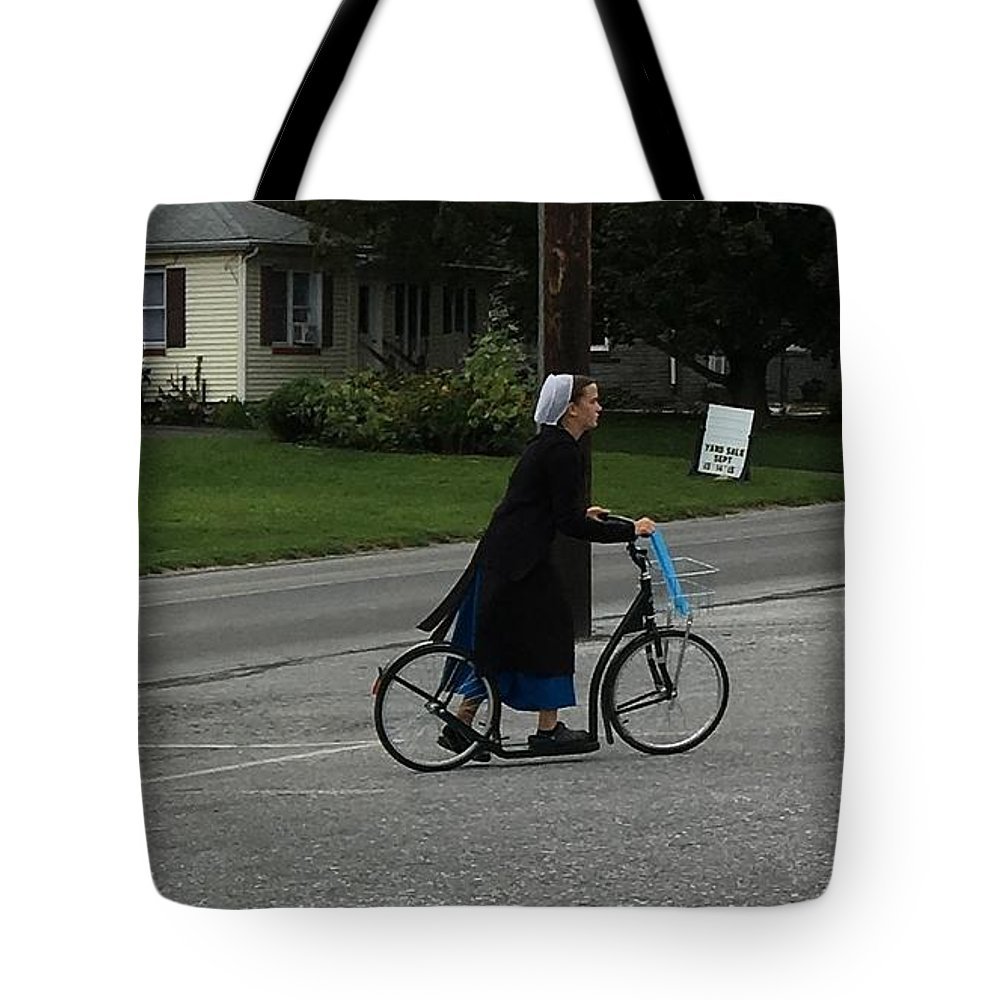 Christine Clark Tote Bag featuring the photograph Amish Girl Going To Work by Christine Clark