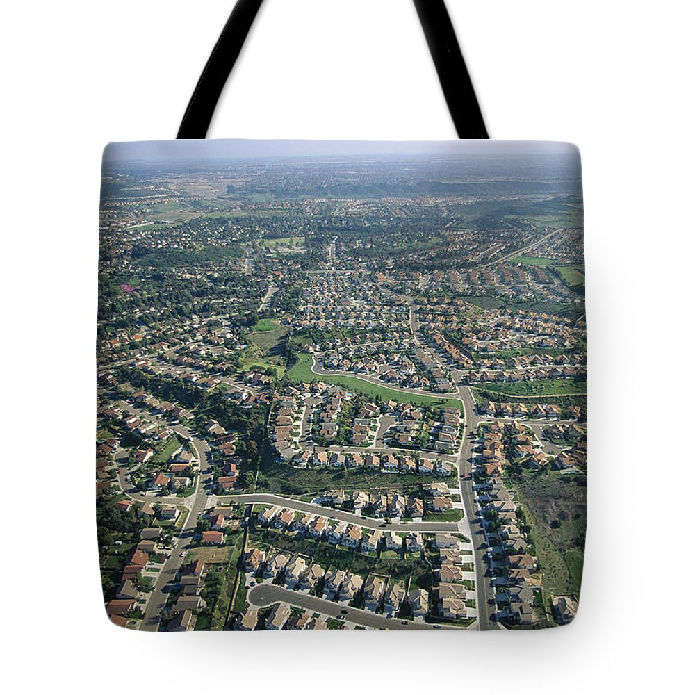 North America Tote Bag featuring the photograph An Aerial View Of Urban Sprawl by Joel Sartore