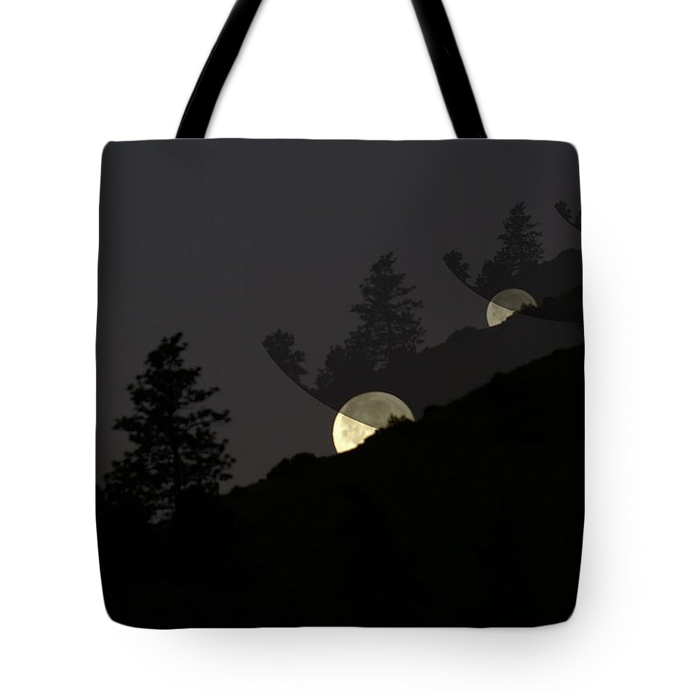 Moon Tote Bag featuring the photograph An Echoing Moonfall by Jeff Swan