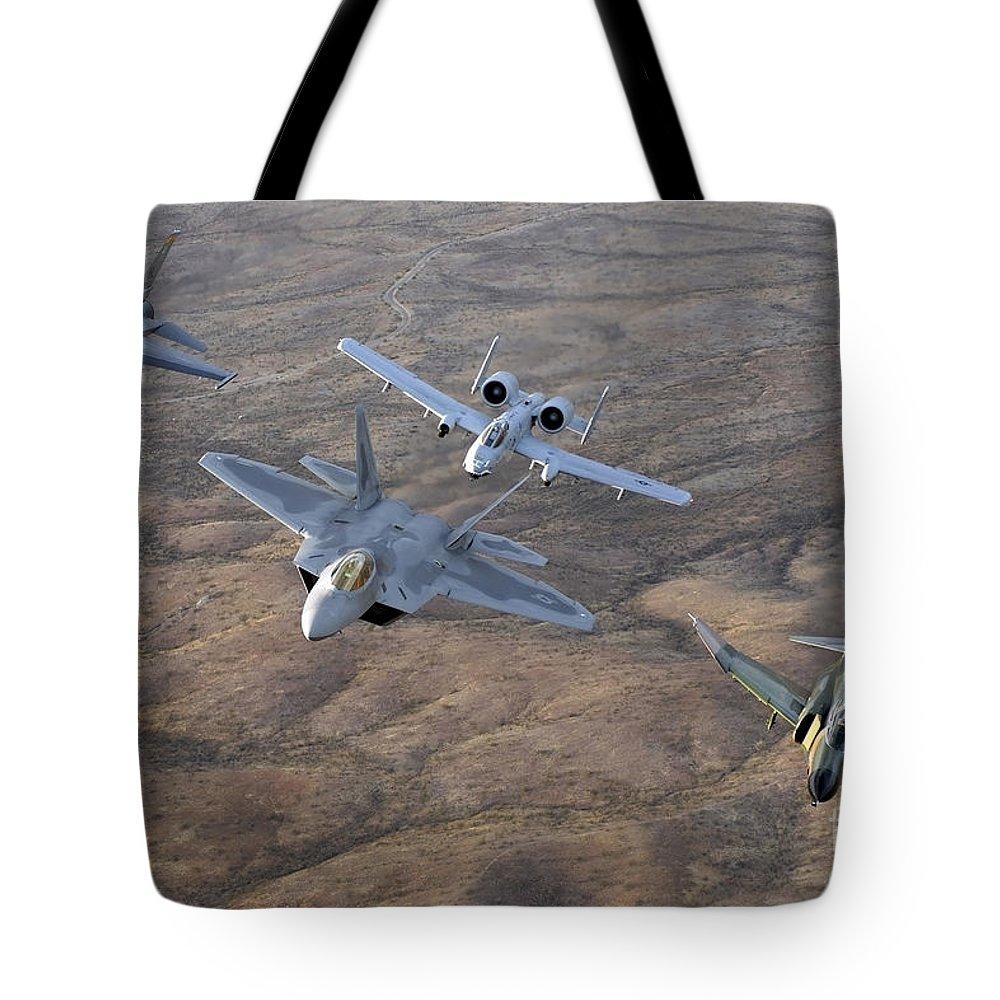 Horizontal Tote Bag featuring the photograph An F-22a Raptor, An F-4 Phantom, An by Stocktrek Images