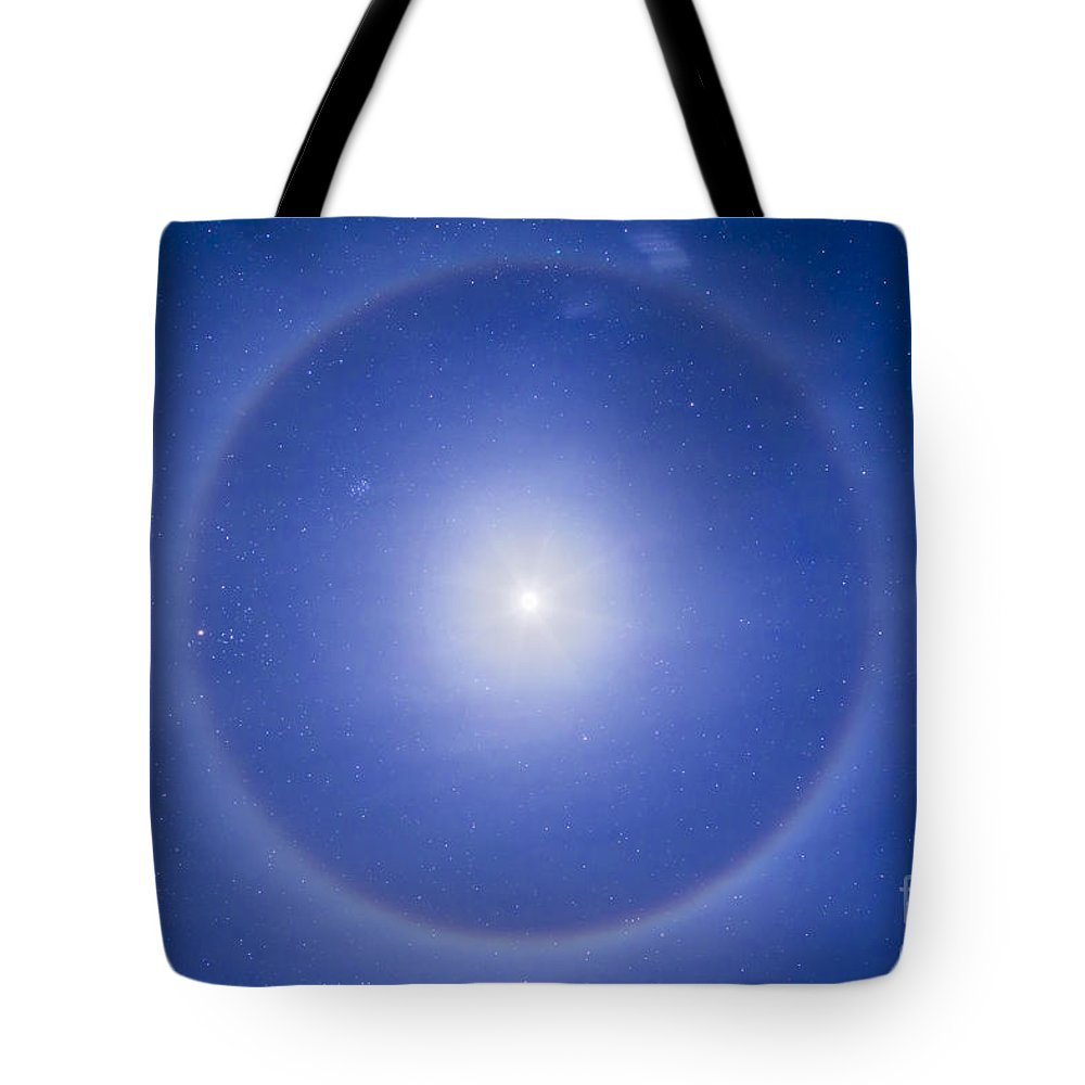 Aldebaran Tote Bag featuring the photograph An Ice Crystal Halo Around The First by Alan Dyer