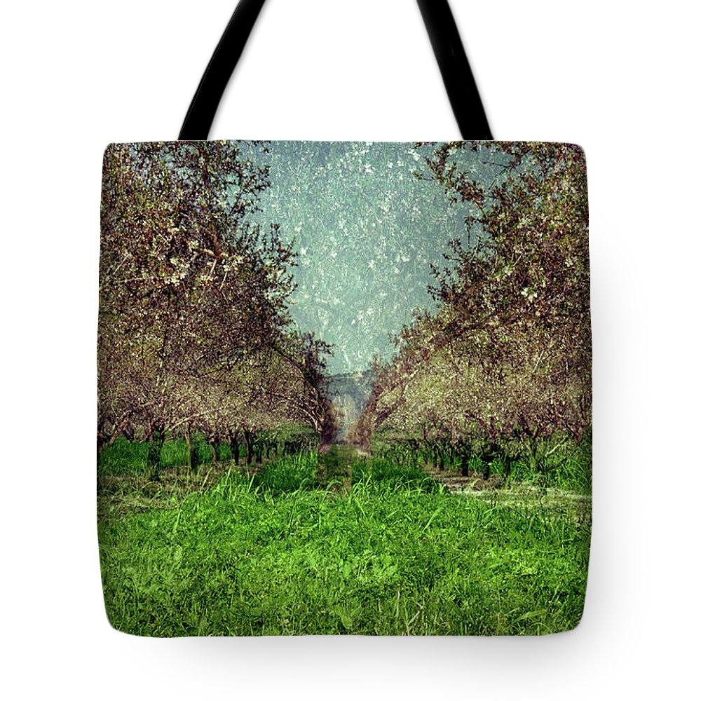 An Orchard In Blossom In The Eila Valley Tote Bag featuring the photograph An Orchard In Blossom In The Eila Valley by Dubi Roman