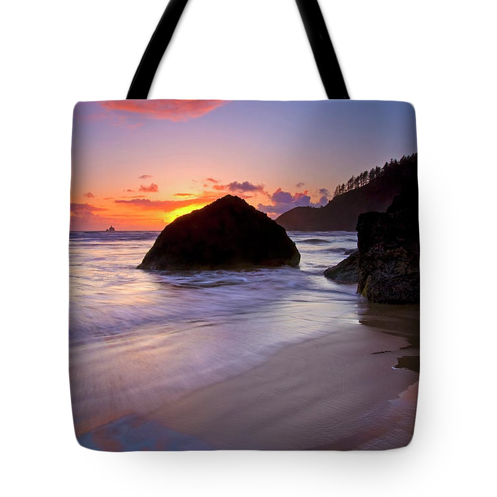 Sunset Tote Bag featuring the photograph Anchoring The Beach by Mike Dawson