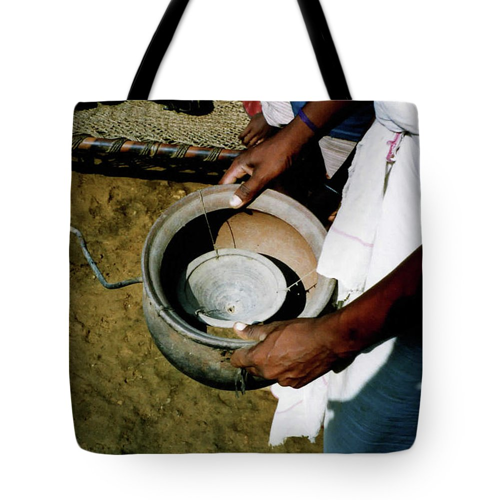 Alcohol Tote Bag featuring the photograph Ancient Device by Ujjwal Rout