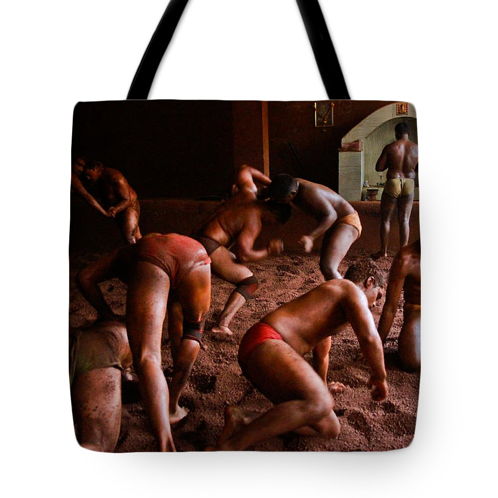 Wrestling Tote Bag featuring the photograph ancient wrestlers of India by Indrajit Khambe