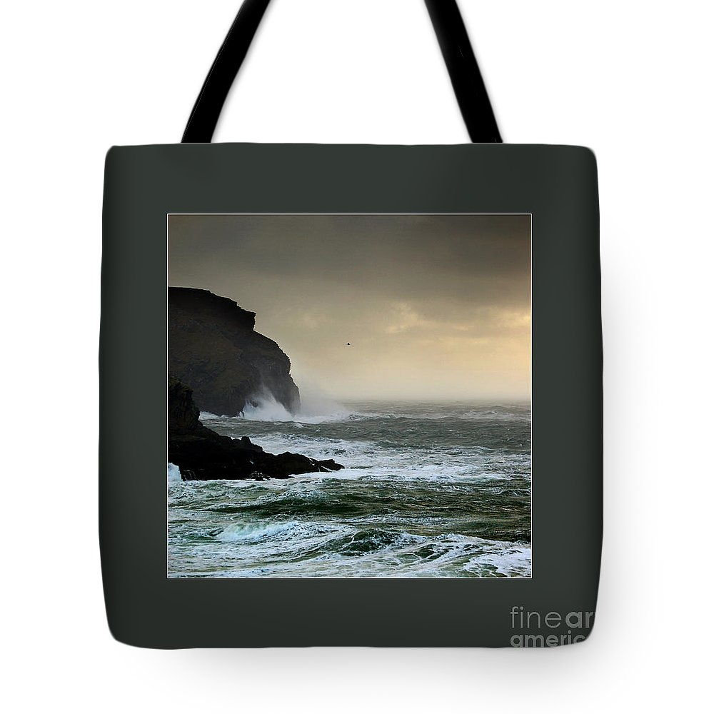 The Sound Tote Bag featuring the photograph Ochre Sky's And Angry Seas 1 by Paul Davenport