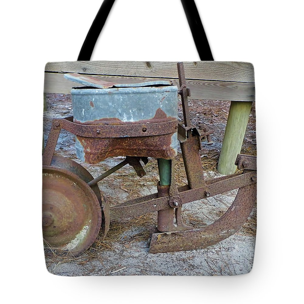 Corn Planter Tote Bag featuring the photograph Antique Corn Planter by D Hackett