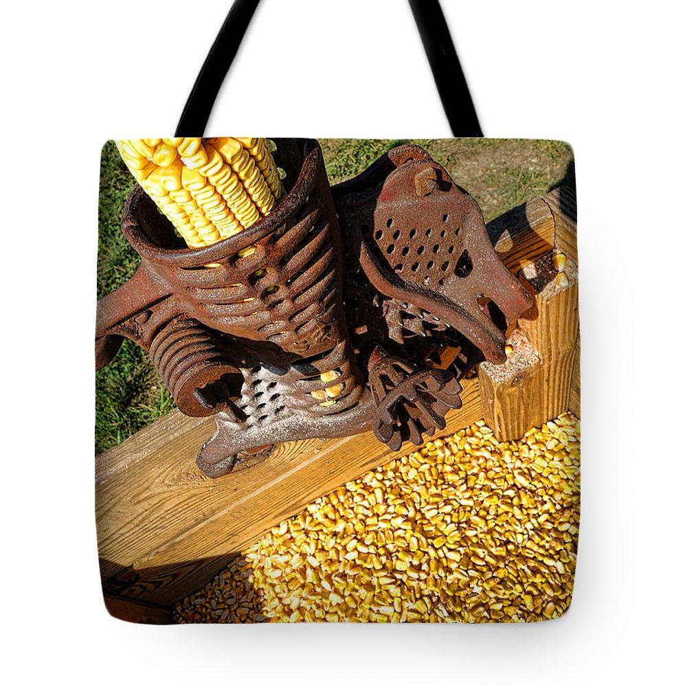 Antique Tote Bag featuring the photograph Antique Corn Sheller by Olivier Le Queinec