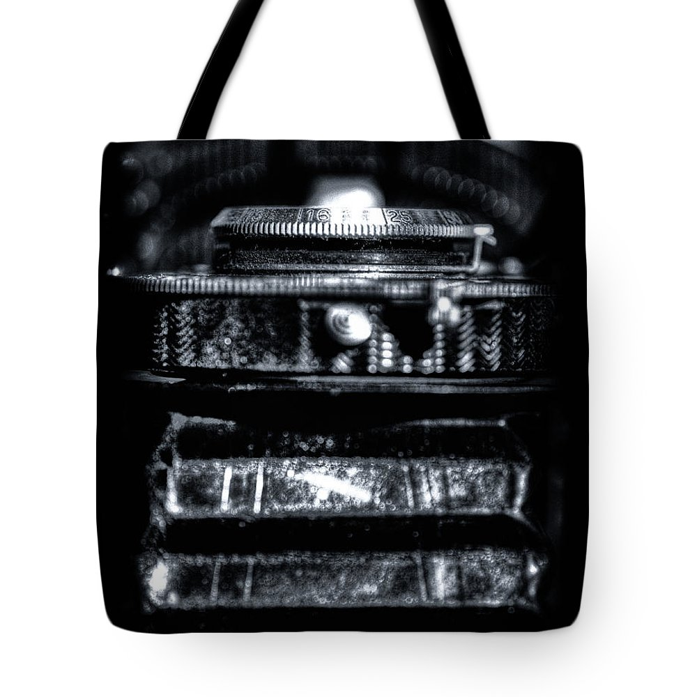 Camera Tote Bag featuring the photograph Aperture Extents by Scott Wyatt