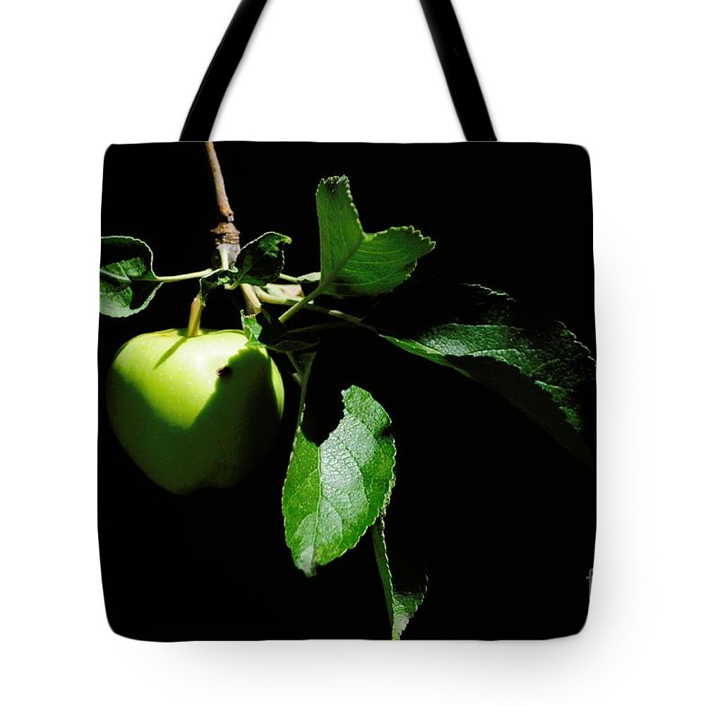 Apple Tote Bag featuring the photograph Apple by Merrimon Crawford