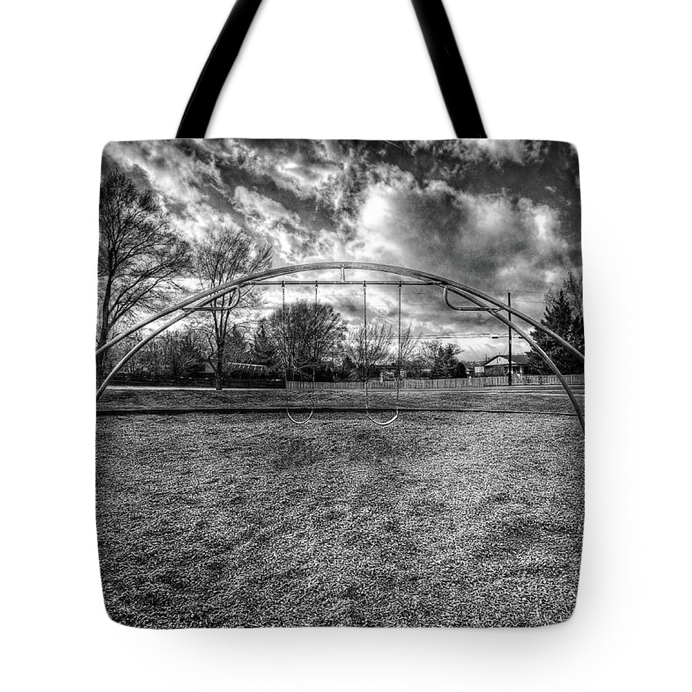 Cloudy Sky Tote Bag featuring the photograph Arch Swing Set In The Park 76 In Black And White by YoPedro