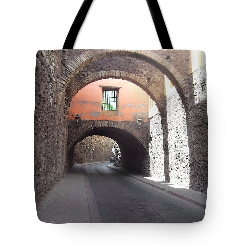 Arch Tote Bag featuring the photograph Arches by Laura Tolley Brown