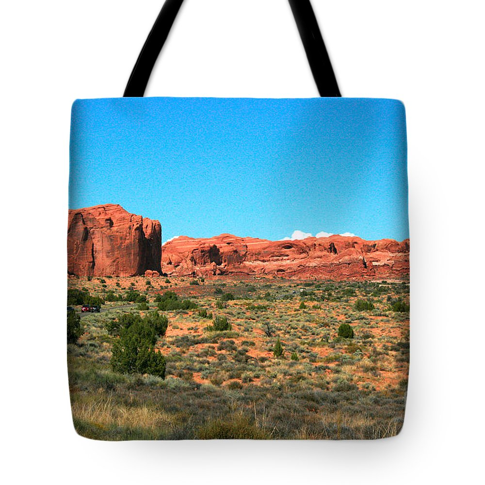 Arches National Park Tote Bag featuring the painting Arches National Park In Moab, Utah by Corey Ford