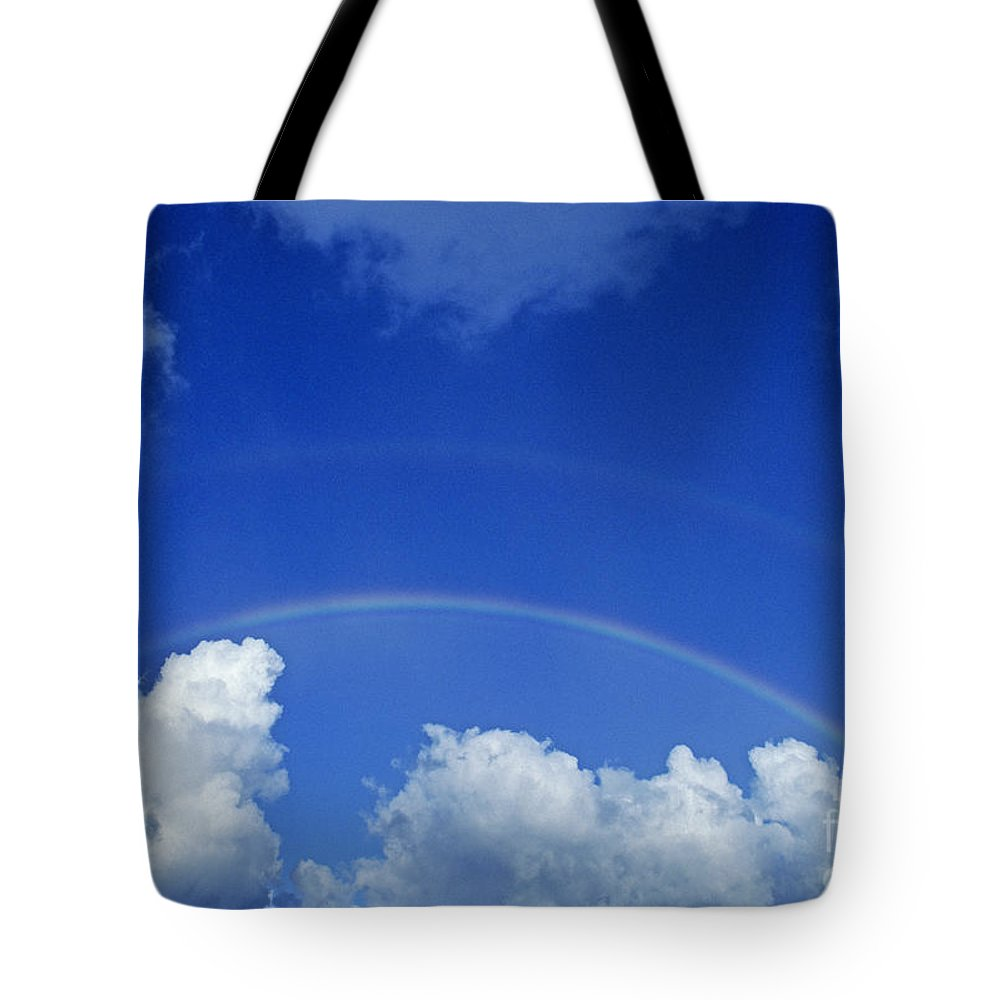 Above Tote Bag featuring the photograph Arching Rainbow by Carl Shaneff - Printscapes