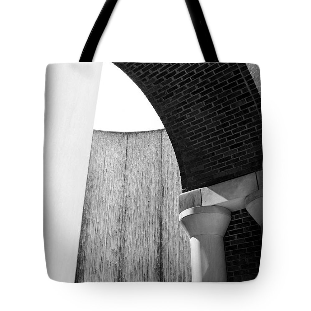 Houstonian Tote Bag featuring the photograph Arcs And Tangents Houston Water Wall In Black And White by Angela Rath