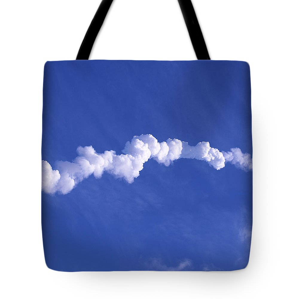Rocket Tote Bag featuring the photograph Area1x Rocket Exhaust Trail by Allan Hughes