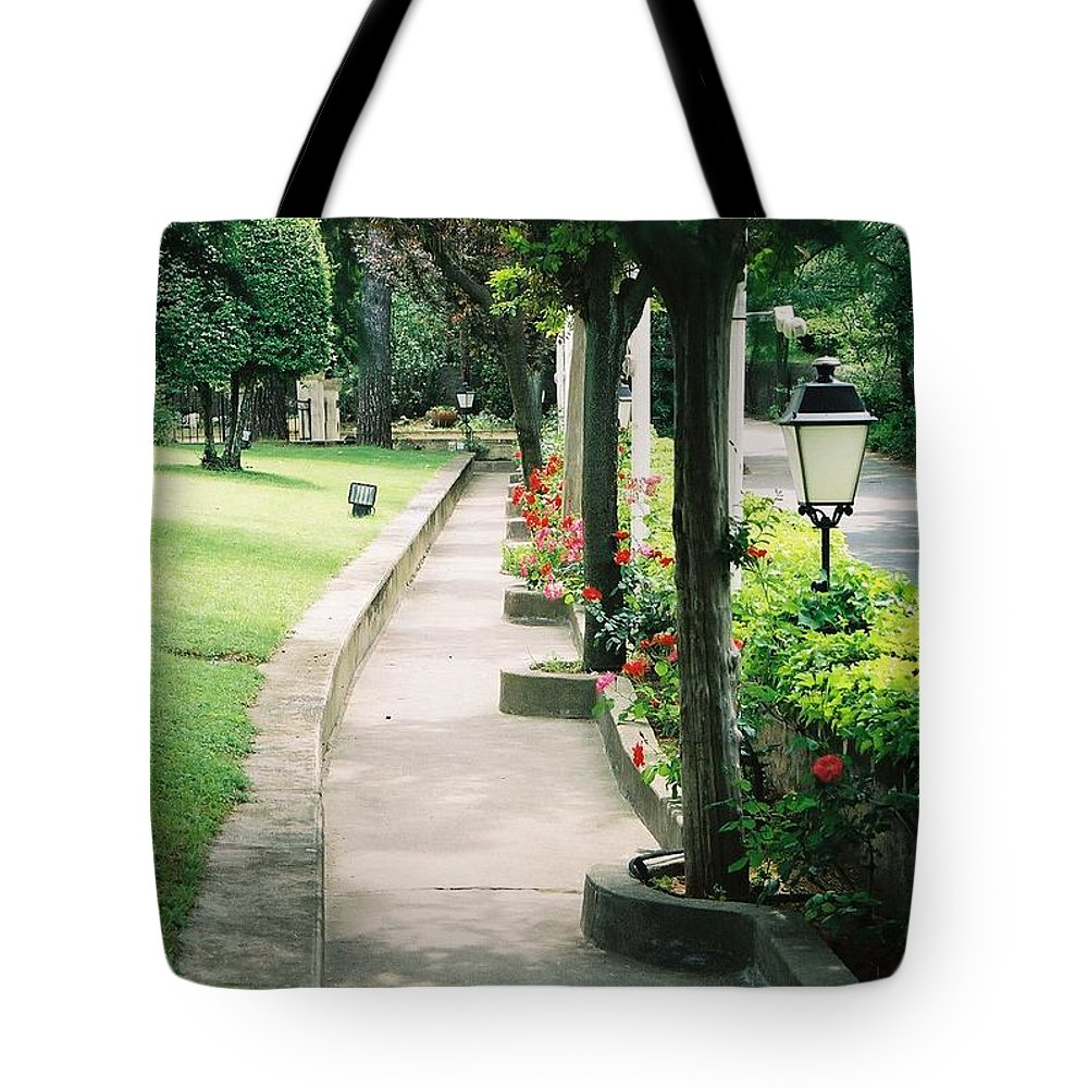 Arles Tote Bag featuring the photograph Arles Walkway by Nadine Rippelmeyer