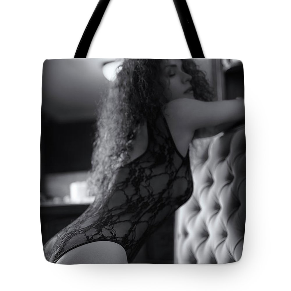 Artistic boudoir black and white portrait of a sexy woman in lac tote bag