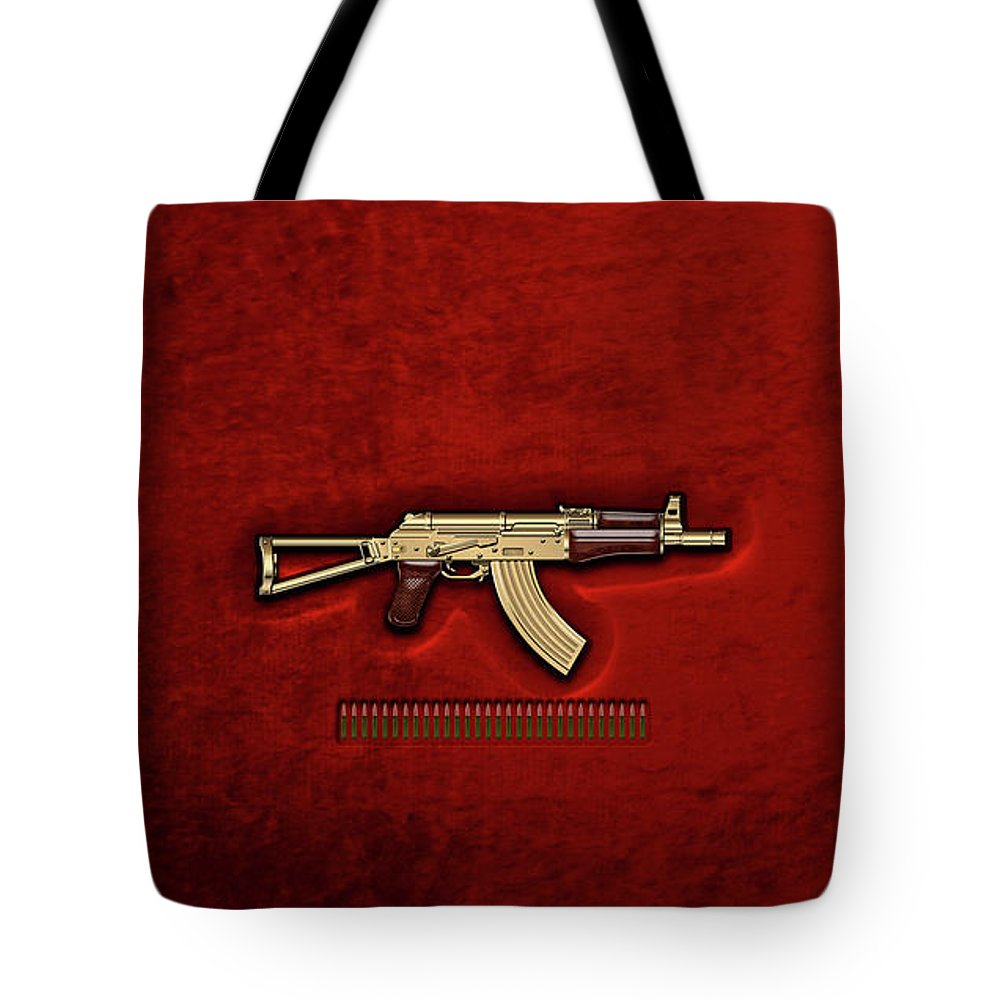 'the Armory' Collection By Serge Averbukh Tote Bag featuring the photograph Gold A K S-74 U Assault Rifle With 5.45x39 Rounds Over Red Velvet  by Serge Averbukh