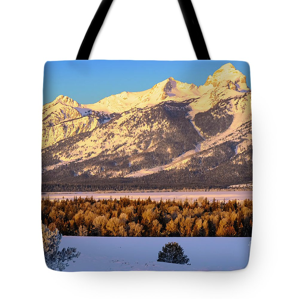 Grand Teton National Park Tote Bag featuring the photograph As The Sun Comes Up by Bob Phillips
