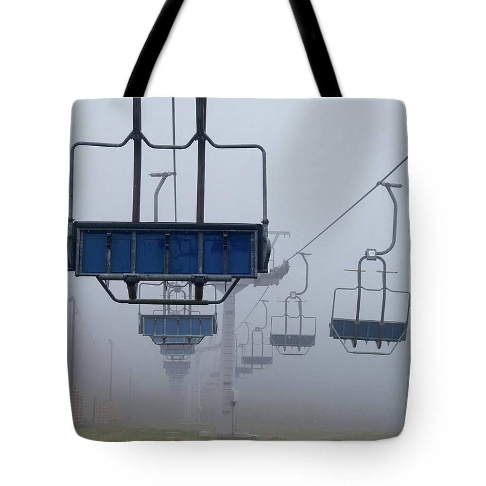 Chairlift Tote Bag featuring the photograph Ascent From The Mist by Rauno Joks