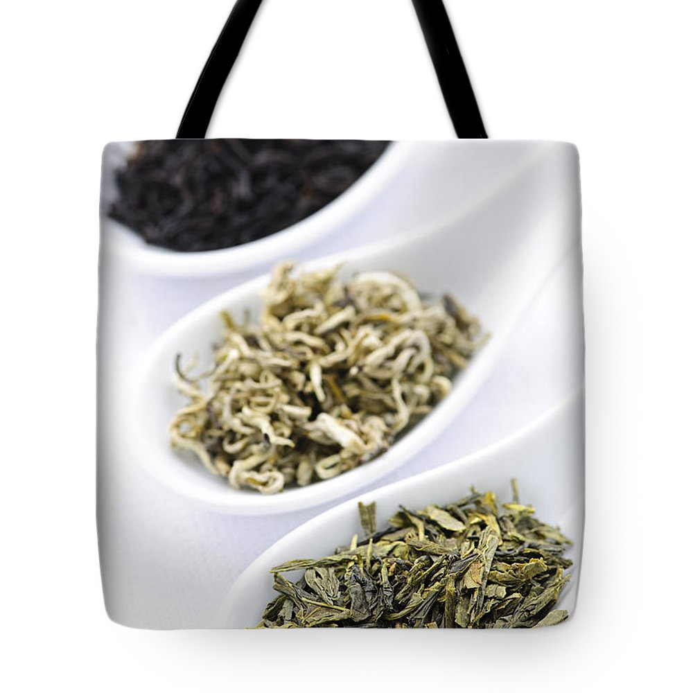 Tea Tote Bag featuring the photograph Assortment Of Dry Tea Leaves In Spoons by Elena Elisseeva