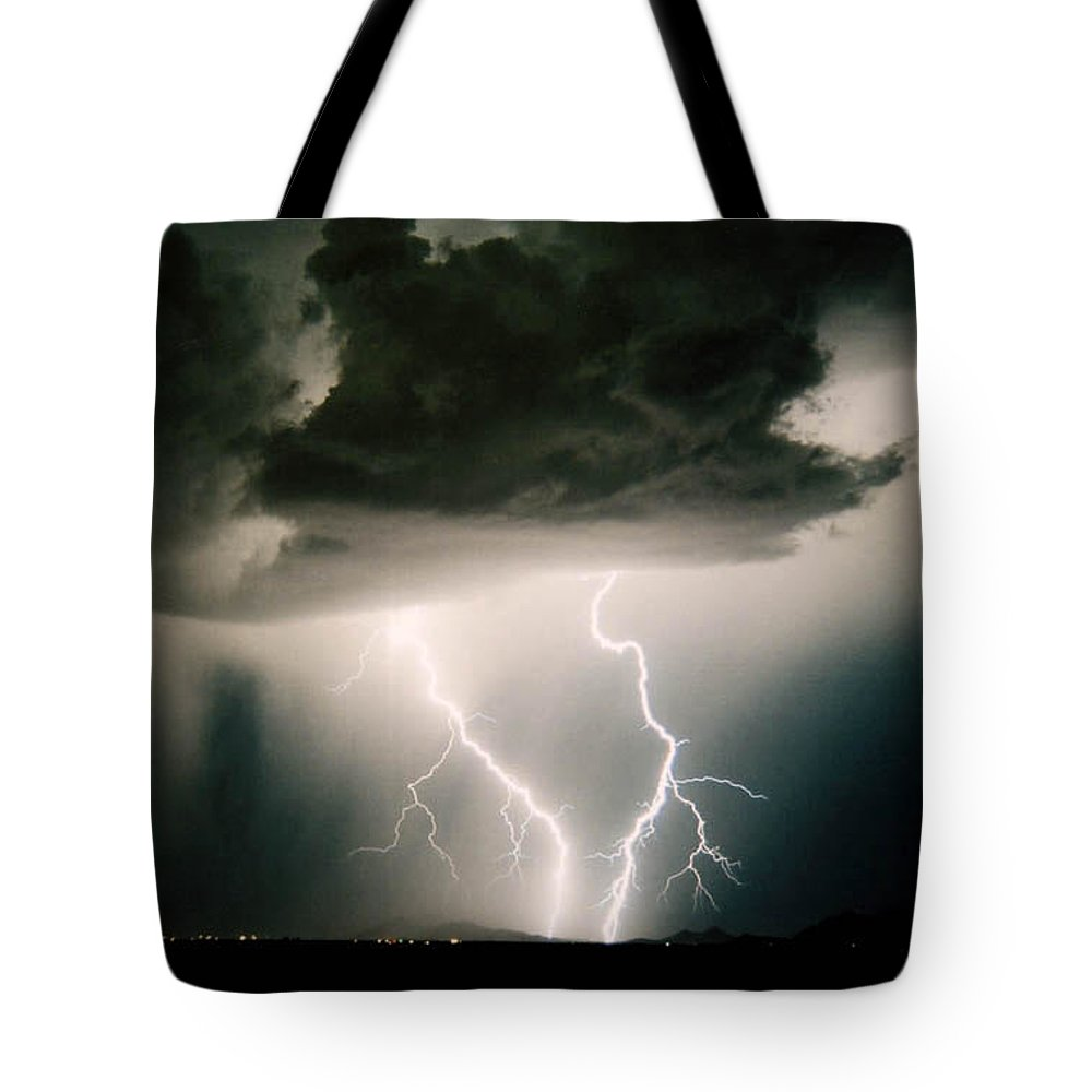 Lightning Tote Bag featuring the photograph Attitude by Cathy Franklin