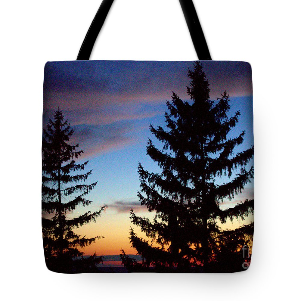 Grand Bend Tote Bag featuring the photograph August Pine Clouds by John Scatcherd