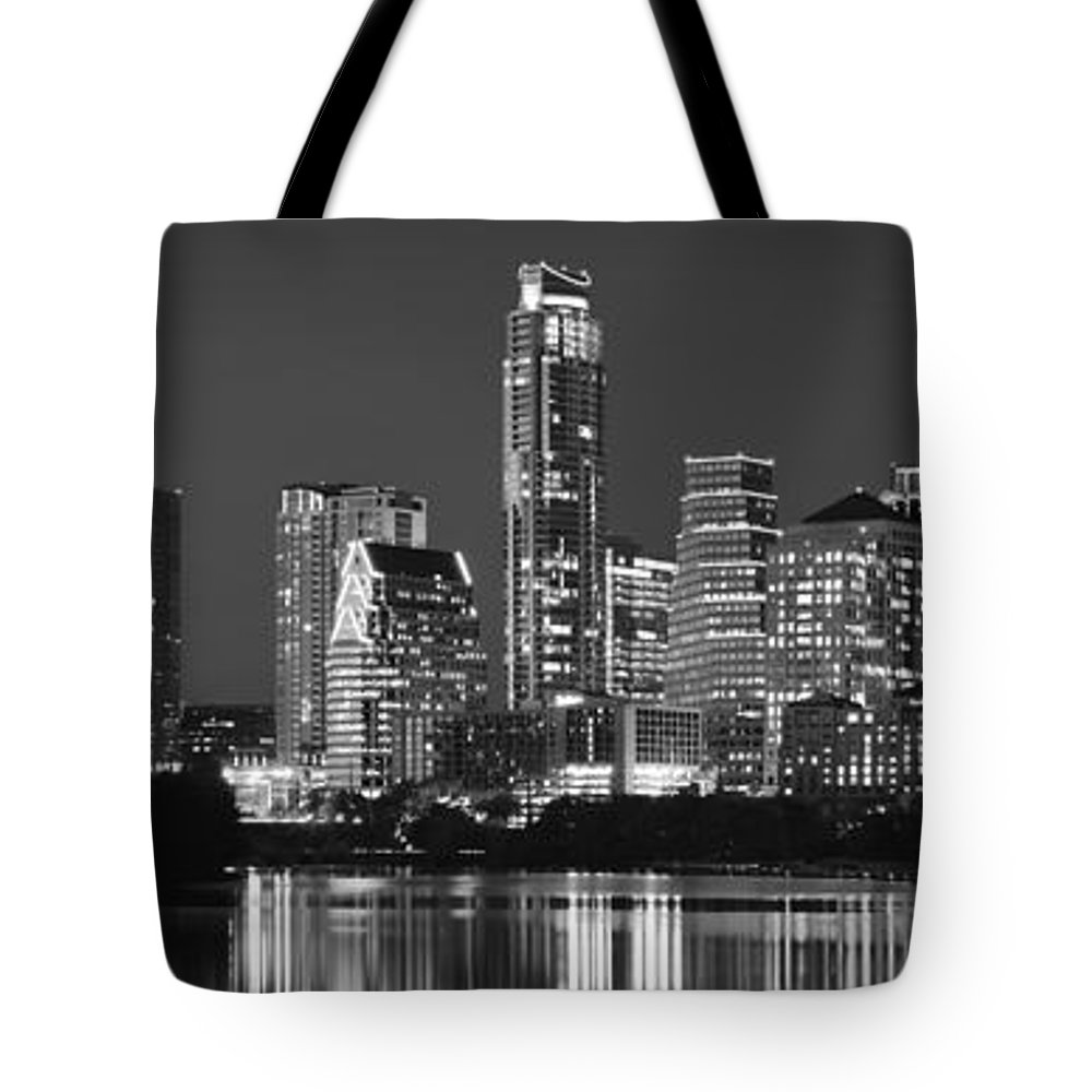 Austin Skyline Tote Bag featuring the photograph Austin Skyline At Night Black And White Bw Panorama Texas by Jon Holiday