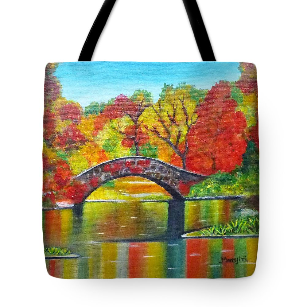 Autumncolors Landscapepainting Fallcolors Orangetree Bridge Flowers Reflection Water Calm Newyork Yellow Blue Lake Colorful Holidayart Giftart Grass Green Tote Bag featuring the painting Autumn Landscape -Colors of Fall by Manjiri Kanvinde