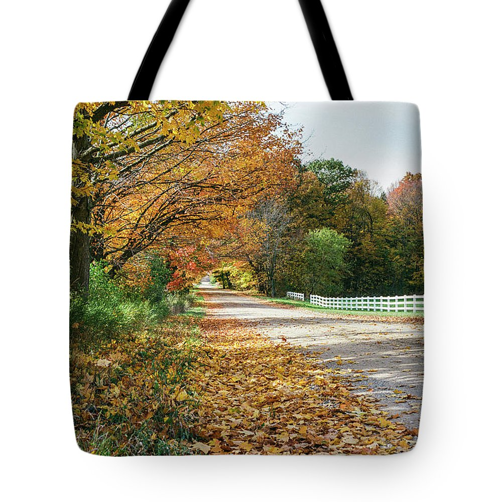 35mm Film Tote Bag featuring the photograph Autumn Road With Fence by John McGraw