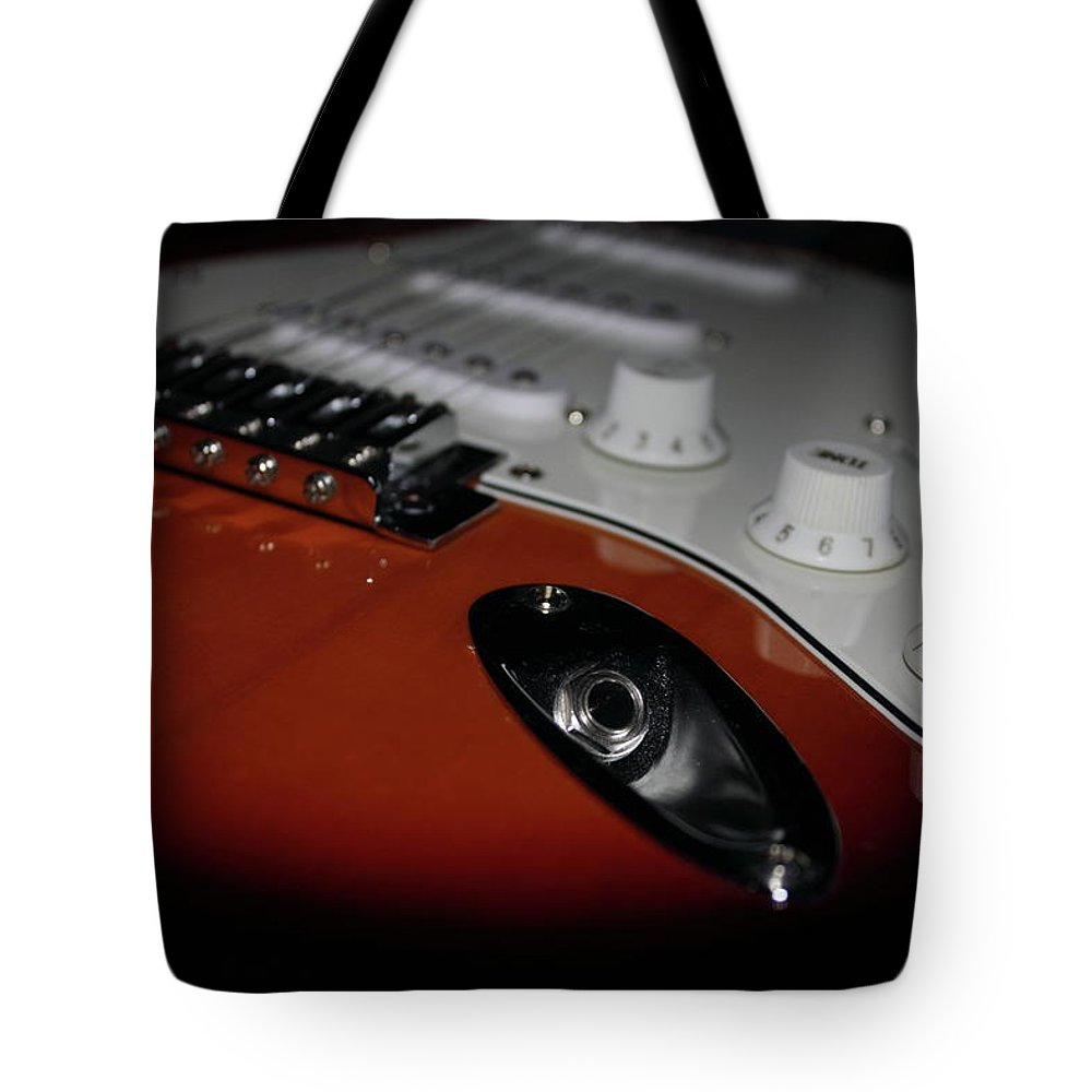 Harrisburg Tote Bag featuring the photograph Axe To Grind by Shelley Neff